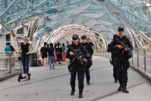 The Police Tactical Unit from the Special Operations Command (left) and officers from the Emergency Response Team (far left) will be part of the 700-strong security team deployed for this year's Marina Bay Singapore Countdown. In addition to boots on