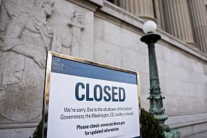 A sign announcing the closure of the National Archives due to the partial government shutdown is displayed in Washington on Thursday. The shutdown is expected to last into next weekend as a House session late on Thursday lasted mere minutes, failing