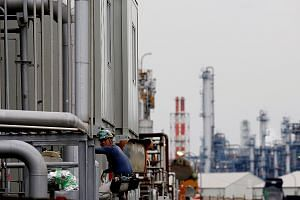 A worker at Keihin Industrial Zone in Kawasaki, Japan. Economists expect factory output and economic growth to rebound in the current quarter after natural disasters hit production and led to a third-quarter economic contraction. But the authorities