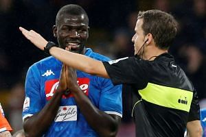 Napoli's Senegalese defender Kalidou Koulibaly was targeted by monkey noises and racist chants before being sent off for sarcastically applauding referee Paolo Mazzoleni during the Italian league game with Inter Milan on Dec 22, 2018.