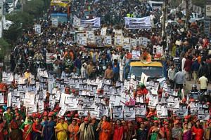 Supporters of Bangladesh Awami League march along a street as they take part in a rally ahead of the Dec 30 general election vote, in Dhaka on Dec 27, 2018.