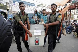 Election officials carrying voting materials to a polling centre ahead of the elections in Dhaka, Bangladesh, on Dec 29, 2018.