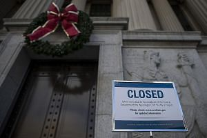 A sign announcing closure of the National Archives in Washington due to a partial government shutdown on display last Tuesday. The partial shutdown is set to be one of the longest in history, the result of an impasse between President Donald Trump an