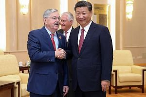US Ambassador to China Terry Branstad meeting Chinese President Xi Jinping at the Great Hall of the People, in Beijing, in 2017. Mr Branstad was denied permission to visit one of the centres opened by the US State Department on college campuses in Ch