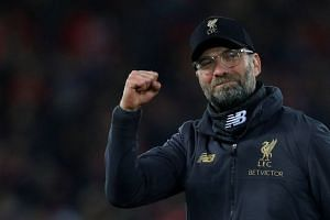 Liverpool manager Juergen Klopp celebrates after beating Arsenal on Dec 29, 2018.