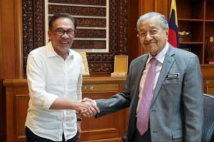 "Datuk Seri Anwar Ibrahim (left) and Prime Minister Mahathir Mohamad met for an hour yesterday. Mr Anwar tweeted that they agreed on ""the same strategies regarding Singapore"""