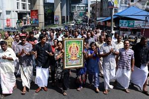 Protesters carry a picture of the Hindu deity Ayyappa at a demonstration following the entry of two women to the Sabarimala temple, in Kochi in southern Kerala state on Jan 2, 2019.
