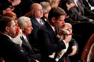 Democrat Representative Eric Swalwell holds his daughter Kathryn as the US House of Representatives meets for the start of the 116th Congress.
