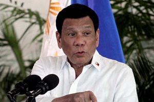 """Mr Talib Abo, a former mayor of a southern town in the Philippines, died after a shoot-out with anti-drug enforcers, hours after President Rodrigo Duterte (above) threatened to slit the throats of """"big-time"""" drug dealers."""
