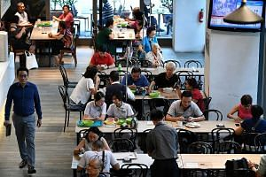 The NTUC Foodfare foodcourt at Khoo Teck Puat Hospital. The chain's foodcourts feature value meals and healthier options. Halim's fish soup comes with thick slices of fish.