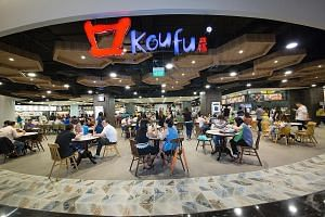 Koufu's foodcourts serve their purpose of feeding the masses and can be found in places like malls and tertiary institutions. Top: Warung K's arang ayam bakar has a smoky aroma. Above: Soon Heng's rojak is full of ingredients.