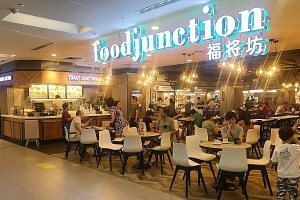 The Food Junction foodcourt at Nex. The chain takes some pains to make its foodcourts look chic and contemporary. Pillowy kueh from Chinatown Tan's TuTu Coconut Cake.