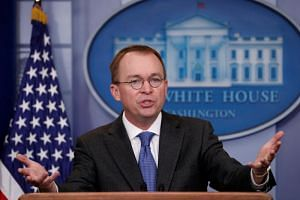 White House budget director Mick Mulvaney gestures as he holds a press briefing at the White House in Washington, US, on Jan 19, 2018.