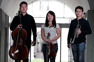 Musicians fulfilling their dreams with the Singapore Symphony Orchestra include young members (from left) Chinese cellist Wang Zihao, 27, Japanese violinist Chikako Sasaki, 28, and Singaporean trumpeter Lau Wen Rong, 28.