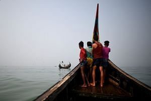 File photo of Rohingya refugees on a fishing boat in the Bay of Bengal near Cox's Bazar, Bangladesh, on March 24, 2018.