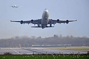 An airplane takes off at Gatwick Airport, after the airport reopened to flights following its forced closure because of drone activity, in Gatwick, Britain, on Dec 21, 2018.