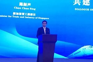 Trade and Industry Minister Chan Chun Sing delivering the opening address at a forum in Chongqing to discuss a new land and sea trade route linking western China and South-east Asia, on Jan 8, 2019.