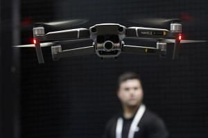 A man pilots a drone at one of the displays, on Jan 8, 2019.