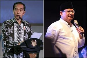 Respondents were asked whether they were aware of four widely spread rumors regarding President Jokowi Widodo (left) and presidential hopeful Prabowo Subianto.