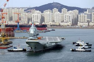 China's first domestically developed aircraft carrier departs the port for its fourth sea trial in Dalian, Liaoning province, China, on Dec 27, 2018.