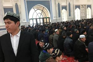 Men pray at a mosque at the Xinjiang Islamic Institute during a government organised trip in Urumqi, Xinjiang Uighur Autonomous Region, China, on Jan 3, 2019.