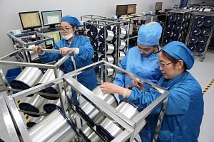 A fibre-optic cable factory in Nantong, China. The US and China have impetus to try and reach a trade deal, but their relationship has become more contentious.