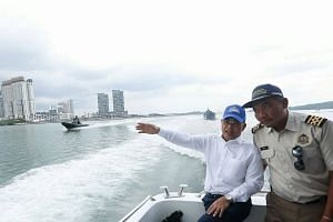 Johor Menteri Besar Osman Sapian made a Facebook post on Wednesday (Jan 9) sharing photos of him visiting Malaysian Maritime Department officials on board the MV Pedoman, which was anchored in Singapore's territorial waters.