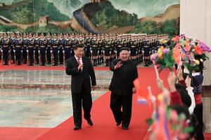 Chinese president Xi Jinping (left) and North Korean leader Kim Jong Un in the Great Hall of the People, where a welcoming ceremony was held before the talks on Jan 10, 2019.