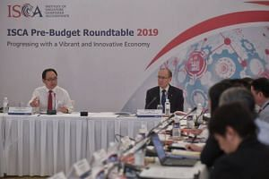 The pre-budget meeting was co-chaired by president of the Institute of Singapore Chartered Accountants. Mr Kon Yin Tong (right), and chairman of the Government Parliamentary Committee for Finance and Trade and Industry, Mr Liang Eng Hwa, at Intercont