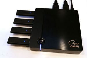 The Straits Times was shown a prototype of Creative's new Sxfi TV media box.