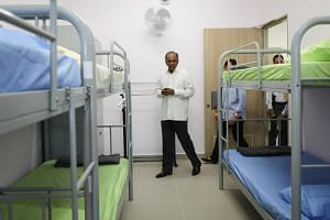 Home Affairs and Law Minister K. Shanmugam touring the women's block of the newly open Selarang Halfway House, which provides aftercare support for former offenders on the Mandatory Aftercare Scheme.