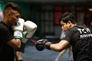 Boxer Muhamad Ridhwan (right) sparring with fellow boxer Mohammed Narish during a training session.