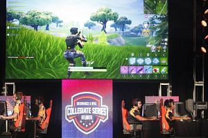 Students from Louisiana State University and The University of Washington compete in the online game Fortnite during DreamHack Atlanta 2018.