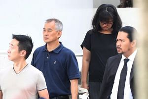 Former taxi driver Yap Kok Hua (in dark blue) was driving along Commonwealth Avenue West when he allegedly failed to give way to a car while making a right turn into Clementi Road and the two vehicles collided with each other.