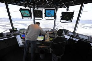 Air-traffic controllers working in the air-traffic control tower at LaGuardia Airport in New York.