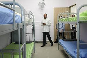 Home Affairs and Law Minister K. Shanmugam touring the women's block of Selarang Halfway House yesterday. The halfway house, Singapore's first such institution to be run by the Government, aims to improve the rehabilitation and reintegration of offen