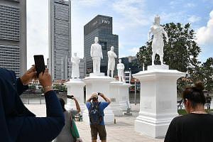 The statue of Sir Stamford Raffles (centre) by the Singapore River has been joined by (from left) community leader Tan Tock Seng, Raffles' secretary and interpreter Munshi Abdullah, treasury chief clerk Naraina Pillai and Sang Nila Utama.