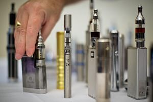 """Nicotine Containing Products"" shown at an e-cigarette meet at the Royal Academy in London in 2013. The HSA advised the public not to buy e-vaporisers, either from the Internet or from overseas. They should also discard those in their possession."
