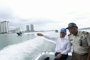 Johor Menteri Besar Osman Sapian made a Facebook post on Jan 9, 2019, sharing photos of him visiting Malaysian Maritime Department officials on board the MV Pedoman, which was anchored in Singapore's territorial waters.