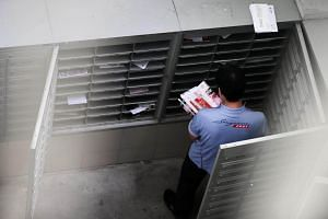 A postman at work at Block 425 Clementi Avenue 1 on Dec 21, 2018.