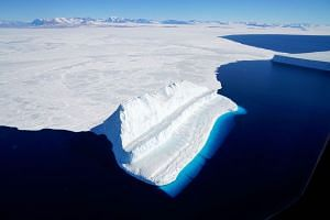 An iceberg floating in Antarctica's McMurdo Sound. Global warming is melting ice in Antarctica faster than ever before - about six times more per year now than 40 years ago.