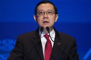 Lim Guan Eng, Minister of Finance of Malaysia, speaks at the Asian Financial Forum in Hong Kong on Jan 14, 2019. Malaysia is gearing up for a fight with Goldman Sachs, which it accuses of helping to carry out an international multibillion-dollar frau