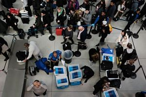 China's State-Owned Assets Supervision and Administration Commission has told some firms to take only secure, company-issued laptops meant for overseas use if travelling is necessary, according to people familiar with the request.