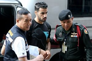 Hakeem Al Araibi (centre, above), who plays in Australia, was arrested in November in Bangkok on an Interpol notice issued at Bahrain's request.