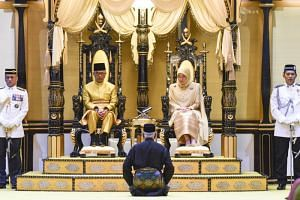 The sixth Sultan of Pahang, Sultan Abdullah ibni Sultan Ahmad Shah (left,) and his consort Tunku Azizah Aminah Maimunah Iskandariah on their thrones during their coronation in Pahang, Malaysia on Jan 15, 2019.