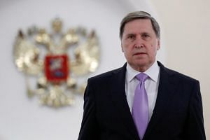 Russia's presidential aide Yuri Ushakov approaches the media after a meeting of President Vladimir Putin with US National Security Adviser John Bolton at the Kremlin in Moscow, Russia, on Oct 23, 2018.