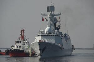 Chinese guided-missile frigate Wuhu prepares to dock at the international port in Manila on Jan 17, 2019.