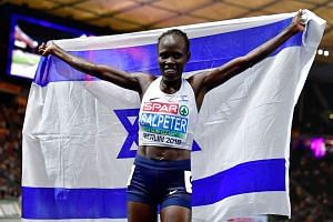 Israel's Lonah Chemtai Salpeter celebrates after winning the women's 10,000m final race during the European Athletics Championships in Berlin in August 2018.