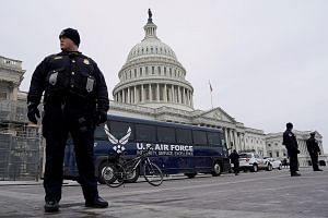 A US Air Force bus meant to transport House Speaker Nancy Pelosi and others to a flight to Belgium and Afghanistan parked outside the Capitol on Thursday after President Donald Trump cancelled the flight as his dispute with congressional Democrats ov