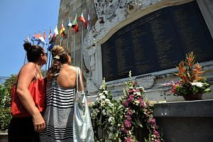 Tourists at the monument for the 2002 Bali bombing victims before a commemoration ceremony on the Indonesian resort island in 2012. News of radical cleric Abu Bakar Bashir's early release from prison came as a rude shock to many observers, including